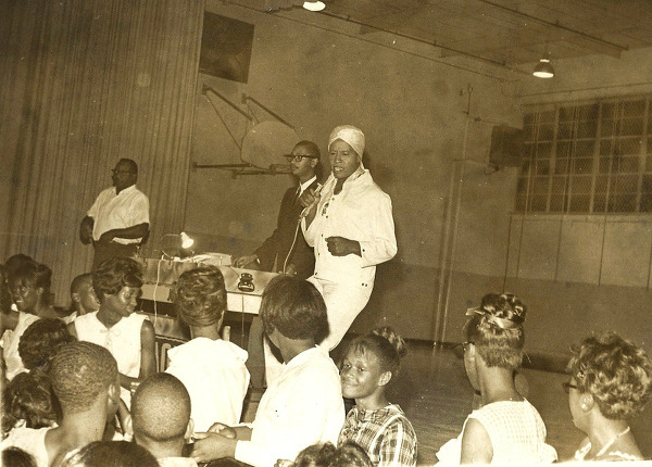 Hannibal performing at a record hop, with WAOK's Burke Johnson, ca. 1966.